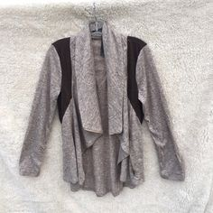 Brown cowl neck waterfall jacket cardigan Gorgeous jacket / cardigan in a heathered light brown / tan with dark brown sections for added contrast. Zipper closure. When unzipped it is flowy like a waterfall cardigan, and zipped up it has a trendy cowl neck. Did have a tiny hole when I purchased right on the seam but I repaired it. New with tags. ‼️NO TRADES‼️ Jackets & Coats