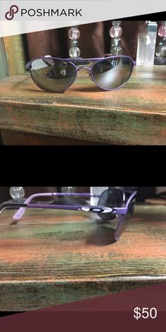 Oakley Aviator sunglasses Purple polarized sunglasses. I wore these quite a bit but still pretty good shape. One or two tiny scratches. Can't see them unless you look close. Oakley Accessories Sunglasses