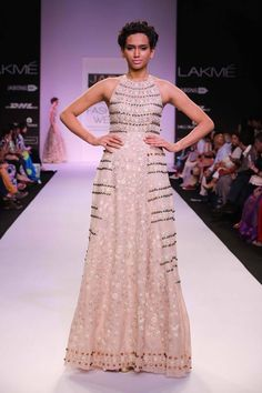 JADE by Monica and Karisma at Lakme Fashion Week Summer Resort 2014 cream metallic beaded dress. More here: http://www.indianweddingsite.com/jade-monica-karishma-lakme-fashion-week-summer-resort-2014/