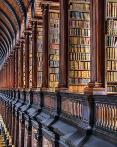 "The Old Library at Temple College, Dublin Ireland by Visualist Images, via Flickr. This library houses ""The Book of Kells,"" from around the 8th Century, and about 200,000 other ancient books. Photo by John Rogers, 2009."