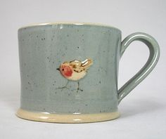 Jane Hogben Robin on blue mug.