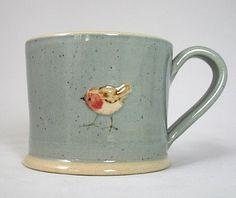 Jane Hogben Robin on blue mug.