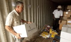 David Torres, the logistics officer for the disaster response team. helps unload medical supplies for the Ebola response.