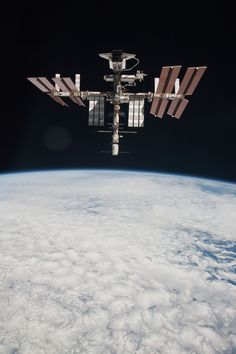 Space Shuttle Endeavour docked with the ISS, as photographed by the departing Soyuz TMA-20 spacecraft on 23 May 2011, during the STS-134 mission.