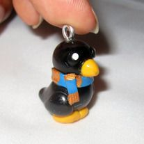 """A cute little charm inspired by the Hogwarts House, Ravenclaw  Handmade out of polymer clay  It measures about 1""""  Since this item is handmade it may look a bit different from the photos.  If requested this charm can be provide with one of the following: A Key Chain, Cell Phone Charm or 1..."""