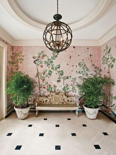 Foyer with chinoiserie wallpaper, by Parish Hadley; this has a lovely airy, garden feel but it's still quite elegant.