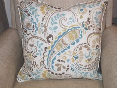 Blue brown and white modern paisley design in cotton linen blend 20x20 pillow cover with blue welting and hidden zipper. Works best with 22x22 insert
