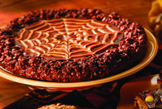 Crispy rice treats 2.0--revamped with chocolate, peanut butter, and delicious spider webbing! Visit http://www.nymetroparents.com/article/Cook-Up-Some-Sweet-Treats-with-the-Kids-this-Halloween-with-Two-Recipes-for-Festive-Desserts#.VEVZ__ldXQM