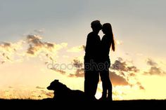 Download - Loving Couple Kiss at Sunset Silhouette — Stock Image #45750571