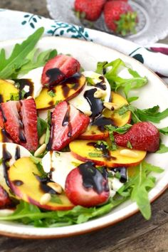Roasted strawberries, sweet peaches, and delicious mozzarella cheese make the BEST summer salad. insidetherustickitchen.com