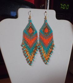 These Native Beaded Earrings are custom made it Turquoise, Orange. They are about 4 in. long with Gold wires on them, can be changed to post or clips. It you have any Questions just ask. Beaded Earrings Patterns, Seed Bead Patterns, Beading Patterns, Seed Bead Jewelry, Seed Bead Earrings, Beaded Jewelry, Hoop Earrings, Jewellery, Native American Beading
