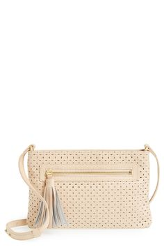 Getting a total retro vibe from this cute perforated crossbody bag.