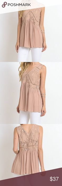 Dressy taupe shirt The perfect Top that every closet needs. This top  features a peplum bottom, lace contrast and a V neckline. Pair this gorgeous top with your favorite white or jean bottoms to get the perfect look.   -65% cotton  -35% nylon   -Cont 100% rayon  -model is wearing size small Tops Blouses