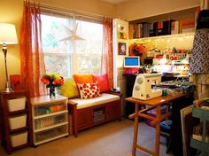 Colorful crafting studio with sewing spot.