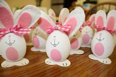Easter bunny eggs with felt ears and gingham bows. They have such funny faces.