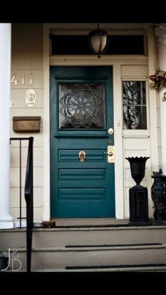 This door is love!  Apparently the color is Sherwin William Peacock Blue.