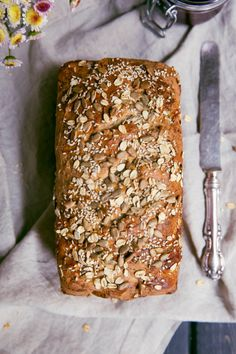 My Grandmother's homemade Honey Oat Bread made with whole wheat flour, sunflower seeds, honey, oats and flax. Nutritious and wonderful toasted for breakfast.