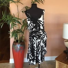 """Black & White Tribal Dress Purchased at Neiman Marcus, 100% silk, fit and flare, peplum waist line, fun and flirty, side zipper enclosure with black eyelet button overlay. 40"""" bust, 32"""" waist, 38"""" long. Great with black boots and jacket. Chetta B Dresses"""