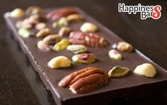 This one is a creation by team happiness bars- Dark Chocolate bar loaded with nuts- pecan nuts, hazelnuts and roasted pistachios! What a nutty bar this one!