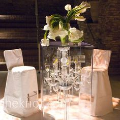 Crystal Chandelier Cocktail Table  Crystal chandeliers within clear cocktail tables are an ultra-modern idea guests are sure to remember. by diane.smith