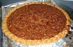 Utterly Deadly Southern Pecan Pie The secret to this rich pie is cooking the sugar and corn syrup first. It is definitely not diet food! I bake this pie for 45 minutes according to my oven but you may need to bake longer. Just Desserts, Delicious Desserts, Yummy Food, Baking Desserts, Yummy Treats, Sweet Treats, Pie Recipes, Dessert Recipes, Cooking Recipes