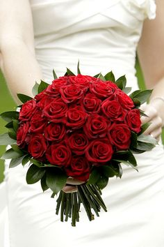 Red Rose Bridal Bouquet, needs some babys breath and rhinestone jewels. Handle needs to be a black n white wrap.