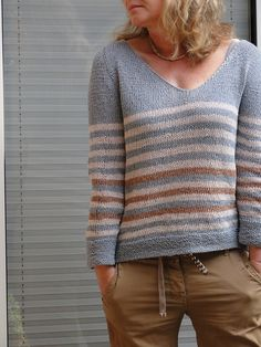 (I like her version of the beach sweater)---Ravelry: baggel's :: On The Beach ::  *Free Pattern