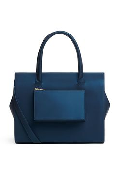 This Season's Best Non-Leather Boots & Bags #refinery29 http://www.refinery29.com/vegan-leather-boots-bags#slide5 The Structured Tote Freedom of Animals Veronika Tote in Navy: Born from stylist Morgan Bogle's love for animals and high-design, this tote boasts vegetable-dyed eco-faux leather, organic cotton lining, and a structured shape that holds all of your daily gear in the most Olivia Pope-esque way.