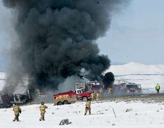 , on Monday, April 20, 2015. Crews worked Tuesday to reopen Interstate 80 in southeastern Wyoming where a fiery chain-reaction crash the day before left one person dead and another in custody. Wreckage from some 60 vehicles involved in the crash was still being removed Tuesday morning. In addition, engineers were assessing damage caused to the pavement by a fire that was started by the crash. (Peter Baumann/Laramie Daily Boomerang via AP)