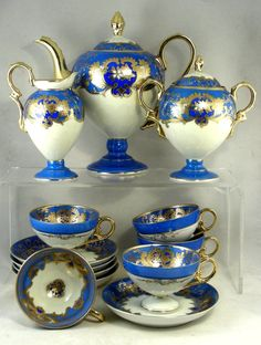 Meito Japanese Tea Set, c. 1910-1930. This tea set was made in Japan for the European market in the early decades of the 20th Century. The brand on the backmark is Meito, but, judging by the shape, it was made by the Noritake factory. Tea sets of this shape, lavishly gilded in 22k gold, were top of the line products. This would have been an expensive item when new, and clearly it's been rarely used, if at all, since.