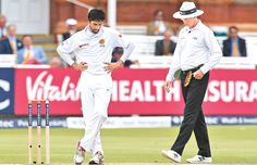Sri Lanka's Nuwan Pradeep (L) reacts after bowling England's Alex Hales, but umpire Rod Tucker (R) calls a no ball during play on the fourth day of the third Test cricket match between England and Sri Lanka at Lord's cricket ground in London on June 12. AFP