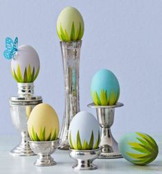 "Cover the bottom of eggs with bright green ""grass"" cut from tissue or origami paper and glued to eggs. More Easter decorating ideas: http://www.midwestliving.com/holidays/easter/easy-easter-decorations/page/14/0"