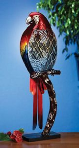 """Bring a little tropical paradise into you home with our Parrot Table Top Fan. Sitting on his perch, this is a bright and colorful decorative parrot fan. Not only is this a functioning electric fan but an attractive decoration as well.  Made of Cast Metal.  Approximately 32"""" Tall x 9"""" Wide.  30 Watt Electric Motor, 2 Speeds. Free Shipping - Continental US only.   https://www.happyholidayware.com/product/funky-parrot-shaped-fan/"""