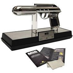 """A sleek, iconic weapon carried by everyone from Will Smith's Agent J to Tommy Lee Jones' Agent K, the J2, or J-Gun, has been recreated here in full scale prop replica form after exhaustive and careful study of the original props to ensure maximum authenticity. Comes with a museum quality display stand, acrylic cover, numbered limited edition plaque, certificate of authenticity and detailed prop story booklet. Limited edition of 1,000 pieces. Requires 2x """"AA"""" batteries, included."""