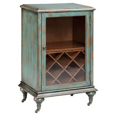 A lovely addition to your kitchen or home bar, this vintaged wine cabinet showcases a distressed hand-painted finish and glass door.   ...