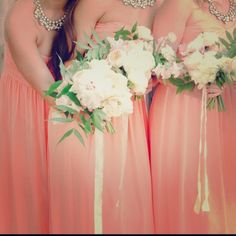 """Donna Morgan coral long strapless bridesmaid dress Wow, wedding season is SO here. This dress was the best strapless bridesmaid dress. It was so flattering and swooshy on the dance floor. It was lovely and I hate seeing it just sit it just sit in my closet. This dress does not scream """"bridesmaid"""" and can be worn for many spring occasions. Donna Morgan Dresses Maxi"""