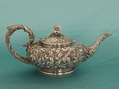 Fancy Victorian sterling repousse teapot made by S. Kirk & Son, Baltimore, MD.  It has a monogram on the bottom along with a signature that dates it between 1868-1890.
