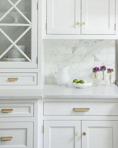 Crisp white cabinetry, brass hardware & Calacatta #thingswelove #cwdportfolio
