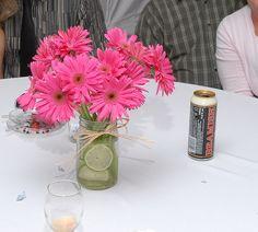 Gerber Daisies in a mason jar, part of wedding centerpieces