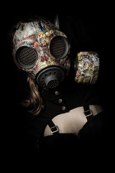 Gas Mask covered with floral cloth, making a contrast between the death/life symbol of the mask and the beauty and feminism of the floral cloth