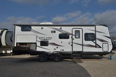 """STUNNING TRAVEL TRAILER!!!  2016 Jayco White Hawk Ultra Lite 24MBH This 27' travel trailer has plenty of room for your family! Comfy bunk beds for kids! There is a murphy bed complete with wardrobes for you! The larger U-dinette is perfect for the whole family to sit around and enjoy meals! This trailer also comes with a outside kitchen and a 12"""" awning to enjoy the beautiful outdoors! Shipping weight is 5455 pounds. Call our White Hawk expert Stuart Brabant 800-949-8271"""