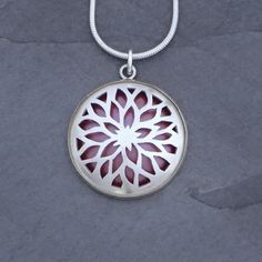 Empowering and bold, this pendant will surely express your unique spirit and passion. The pierced sterling silver reveals a layer of vibrant, flame-patinated co
