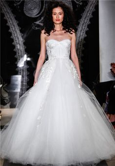 Strapless tulle ballgown with hand draped bodice and cascading embroidered detail