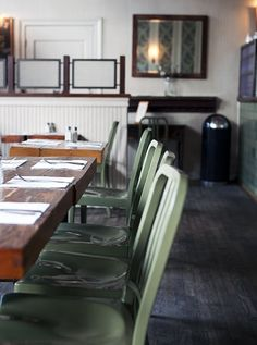 US Navy Chairs in a lovely green compliment the wooden table beautifully