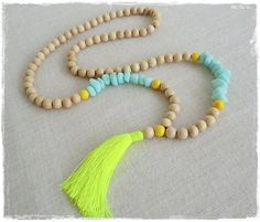 Boho neon tassel necklace - sea mist resin beads and blonde wood bead tassel necklace with neon yellow tassel on Etsy, $27.53 AUD
