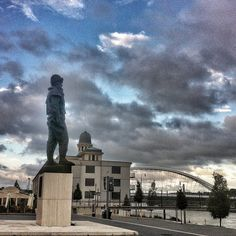 Apollo bridge and Stefanik statue next to Eurovea and the Danube river (Bratislava)