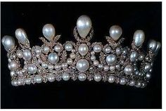 """Empress Eugenie's tiara, c. 1850. Napoleon had jeweler Alexandre-Gabriel Lemonnier (c. 1808-1884) make this piece in the Louis XVI style, a filigree silver-gilt mount over-crusted with 1998 small diamonds. They surround much larger pearls, and give them absolute priority. The largest drop-shaped pearl in the top-most position is believed to be the """"Perle Napoleon"""""""