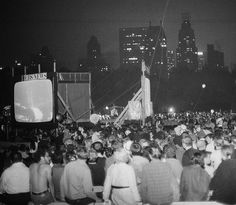 July 20, 1969 — A crowd watches as the Apollo 11 crew lands on the moon in Central Park, NYC.