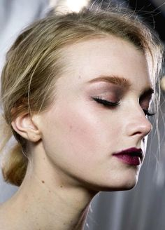 During winter time you can never go wrong with a dark lip and minimal eye shadow.