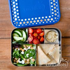 Greek-inspired vegetarian lunch of salad, pita, hummus, cucumbers and tomatoes in #LunchBots Cinco.
